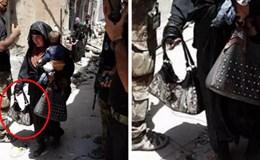 Lạnh người ảnh nữ chiến binh IS bế con đi đánh bom liều chết ở Mosul