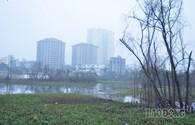 Hà Nội mờ ảo trong sương sáng ngày 30 Tết Giáp Ngọ