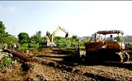 Xử lý thế nào khi không chịu giao đất để thực hiện dự án?