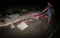 Thị trưởng Philippines bám trên mái nhà chống chọi bão