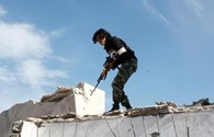 Hãi hùng hàng trăm thi thể IS trong nhà lạnh chờ hồi hương