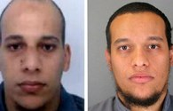 Video mới nhất về hai kẻ tấn công Charlie Hebdo tẩu thoát xả súng vào cảnh sát