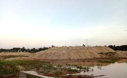 Tích trữ hàng nghìn mét khối cát trái phép trên đất quốc phòng