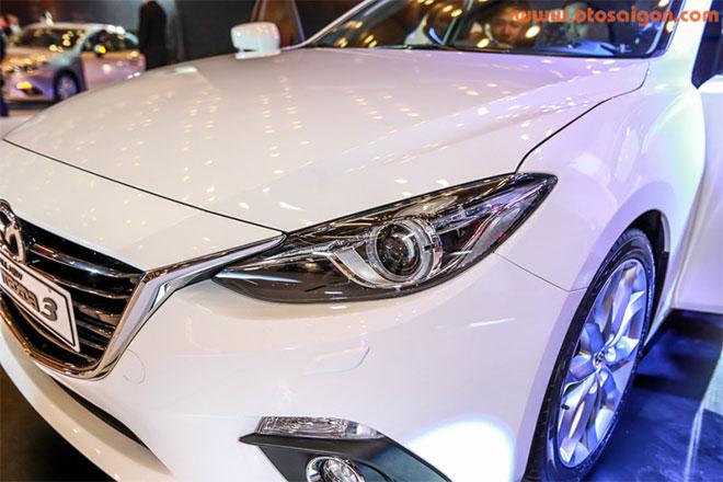 Thiết kế đèn pha và đầu xe của Mazda3.Ảnh Otosaigon